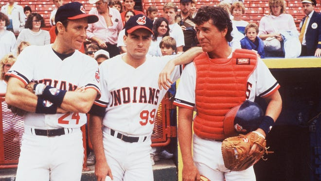 """Corbin Bernsen (from left), Charlie Sheen and Tom Berenger take a break on the sidelines in """"Major League,"""" in a scene shot at Milwaukee's now-departed County Stadium."""
