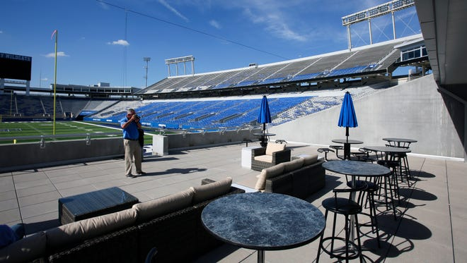 The new UK football recruiting room at Commonwealth Stadium has a deck overlooking the field and the seats the recruits sit in for the game. Sept. 24, 2015