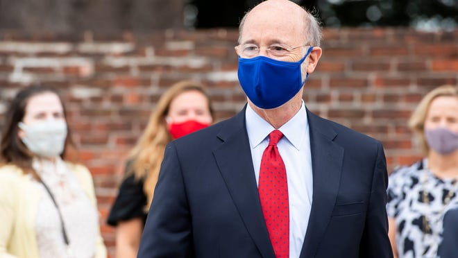 Governor Tom Wolf visits arrives for a press conference in Harrisburg, Pa., on Monday, August 31, 2020.