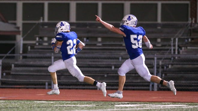 Andover's Max Middleton (22) runs for a touchdown in the fourth quarter on Friday, Oct. 9 in Andover, Kansas. The Junior finished with 263 yards rushing and three touchdowns.