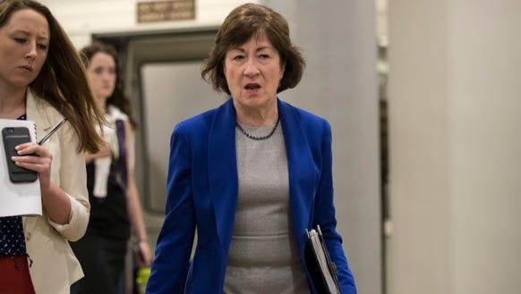 Sen. Susan Collins, R-Maine, arrives for a briefing