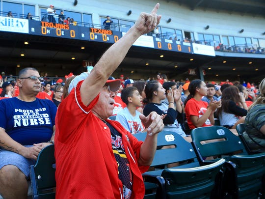 Reynaldo Torres cheers on as he prepares to watch the Ray and Moody game 1 of the Region IV-5A finals Thursday, June 1 ,2017, at Whataburger Field in Corpus Christi.