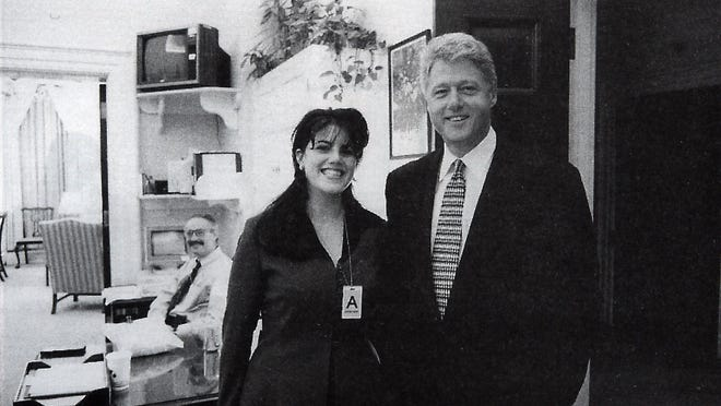 This photo of Monica Lewinsky and President Bill Clinton was taken at the White House in 1995.  (AP)