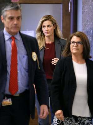 Sportscaster and television host Erin Andrews, center, walks to the courtroom Wednesday, March 2, 2016, in Nashville.