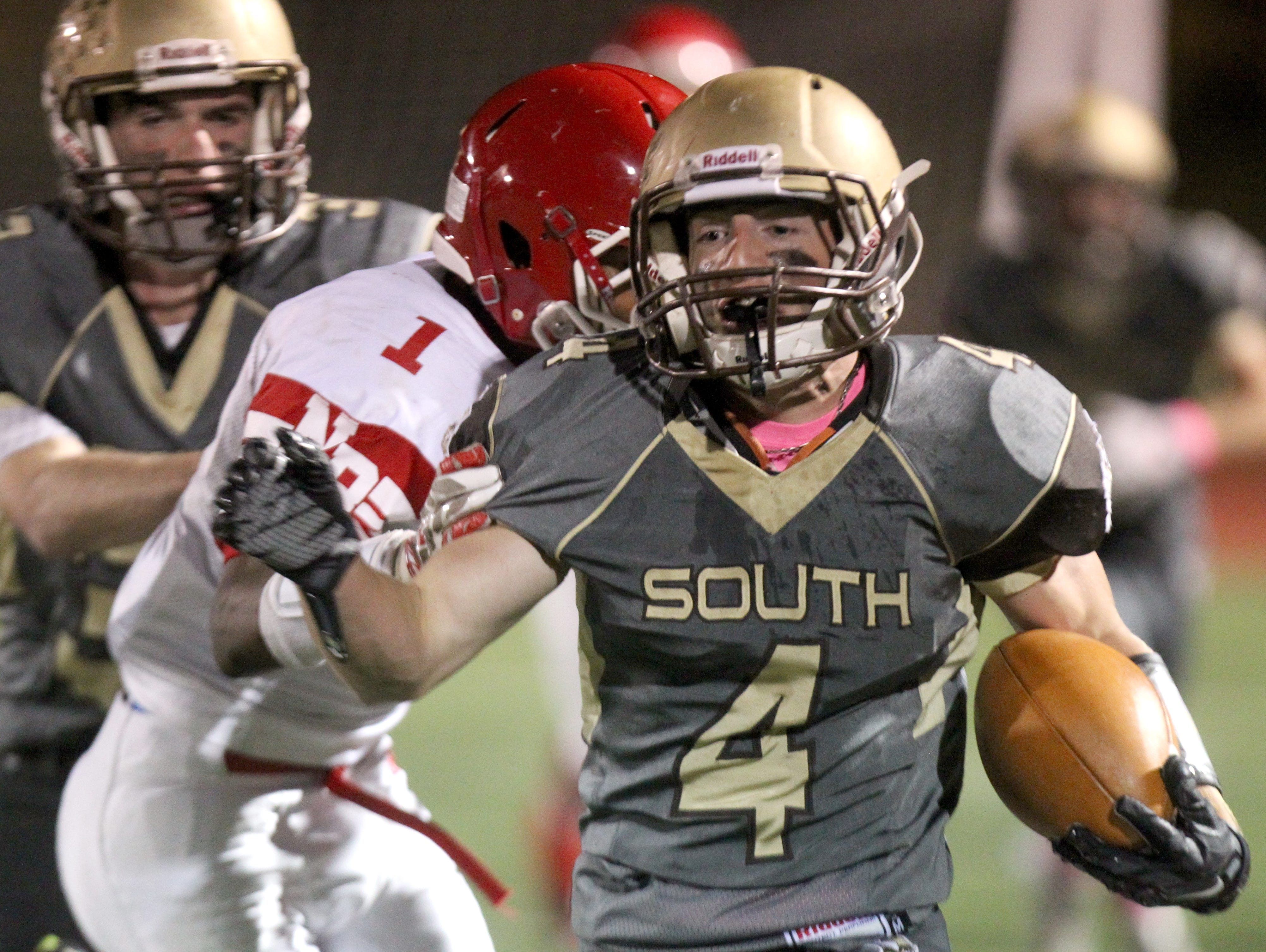Clarkstown South's Kyle Samuels breaks past North Rockland's Lamar Seward during their Class AA qualifying round game at Clarkstown South Oct. 16, 2015.