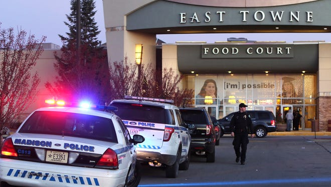 """Authorities respond to reports of shots fired at East Towne Mall in Madison on Saturday. Madison police said one person was shot in the leg during a """"disturbance"""" inside the mall but his injuries are not life threatening."""