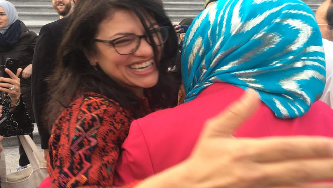U.S. Rep. Rashida Tlaib, D-Detroit, greets supporters outside the U.S. Capitol after being sworn in on Jan. 3, 2019.