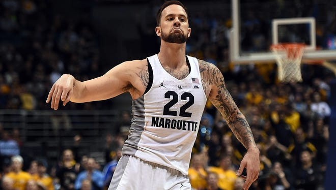 Marquette's Katin Reinhardt reacts to a three-point shot during the second half against Villanova on Tuesday night at the BMO Harris Bradley Center. Reinhardt scored 18 of his 19 points in the second half of the Golden Eagles' upset victory.