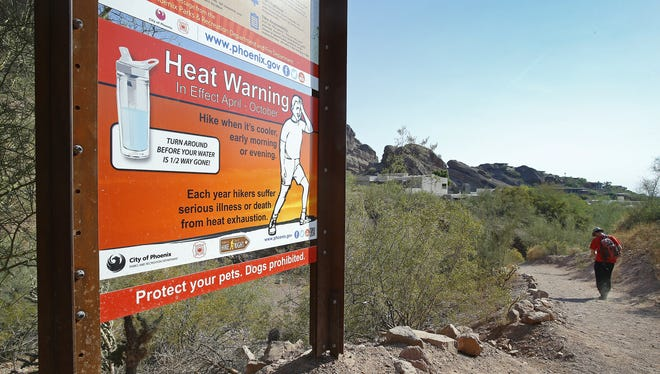 A hiker starts out at the Echo Canyon Trailhead on Camelback Mountain as temperatures reach  nearly 120 degrees June 19, 2017 in Phoenix.