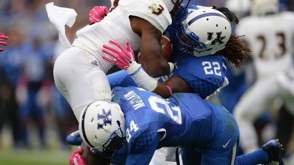 UK players Khalid Henderson and Blake McClain tackle  