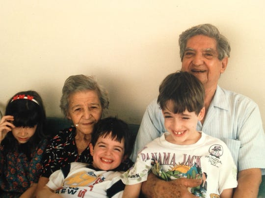 Raymond Ferrer with his wife and grandchildren.