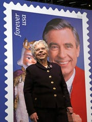 Fred Rogers' wife, Joanne, stands in front of a giant Mister Rogers Forever Stamp following the day-of-issue dedication in WQED's Fred Rogers Studio in Pittsburgh.