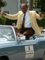 Grand Marshall of the 8th Annual African American Parade James Riley Sr. is all smiles as waves to the parade watchers, Aug. 4, 2007.