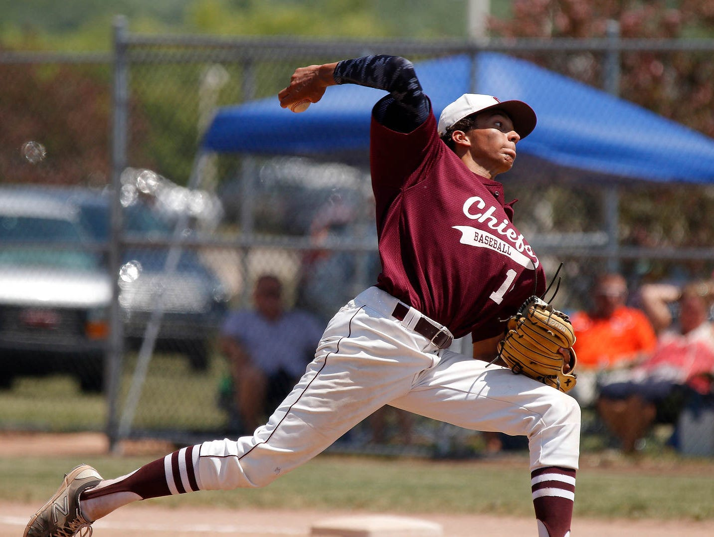 Okemos' A.J. Matusz delivers a pitch against Portage Northern in their Division 1 regional semifinal game Saturday, June 11, 2016, at Holt High School. Okemos fell 13-3.