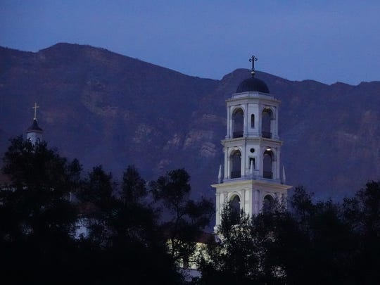 Los Padres National Forest land rises behind the Thomas Aquinas College campus, providing popular hiking trails.