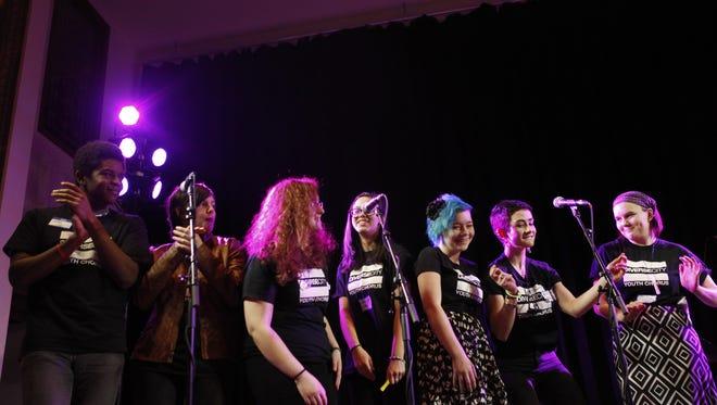 Diverse City Youth Chorus performs at a vigil to remember Leelah Alcorn at The Woodward Theater in Cincinnati, Saturday, Jan. 10, 2015.