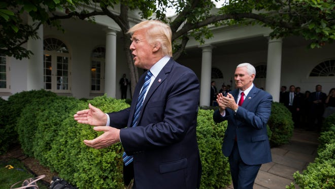 President Trump and Vice President Pence cheer House Republicans on May 4, 2017.