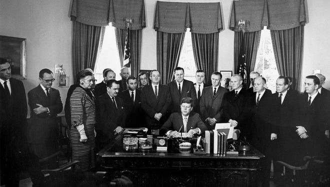 September 1961: Signing of the Peace Corps. Bill  Credit Abbie Rowe. White House Photographs. John F. Kennedy Presidential Library and Museum, Boston.