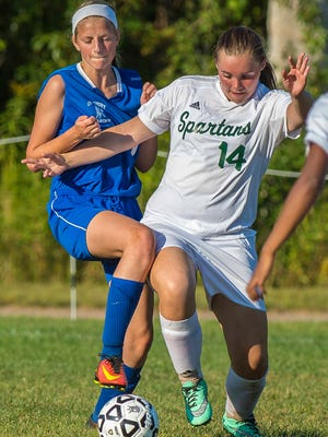 Winooski's Mariah J. Metevier, right, controls the ball against Craftsbury's Emily Morse in Winooski  on Tuesday, September 6, 2016.