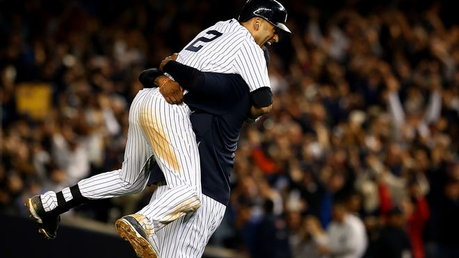 New York Yankees shortstop Derek Jeter celebrates after a game-winning RBI hit in the ninth inning against the Baltimore Orioles in his last game ever at Yankee Stadium on Thursday in New York