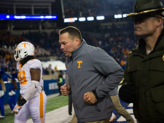 Tennessee Head Coach Butch Jones runs off the field