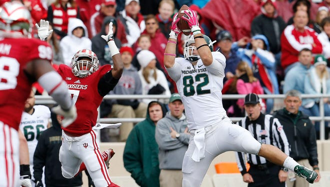 Michigan State tight end Josiah Price (82) hauls in a pass against Indiana in the first half of an NCAA college football game in Bloomington, Ind., Saturday, Oct. 18, 2014