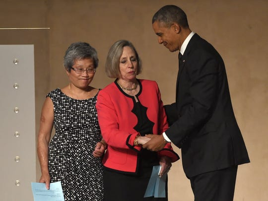 US President Barack Obama with Alison Crowther and Ling Young at the dedication of the national September 11th Memorial Museum in New York, May 15, 2014.