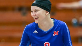 Martinsville volleyball sophomore Bridget Balcerak laughs with teammates while warming up before facing Columbus North at Martinsville High School, Martinsville, Ind., Thursday, Sept. 21, 2017. Balcerak has continued playing volleyball while undergoing chemotherapy for stage IIA Hodgkin lymphoma.
