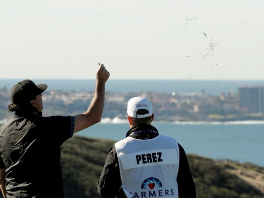 Pat Perez checks the wind on the third hole during the second round of the Farmers Insurance Open golf tournament on the South Course at the Torrey Pines Golf Course Friday, Jan. 27, 2017, in San Diego. (AP Photo/Chris Carlson)
