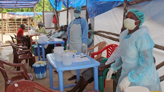 Medical personnel inside a clinic take care of Ebola patients in the Kenema District on the outskirts of Kenema, Sierra Leone.