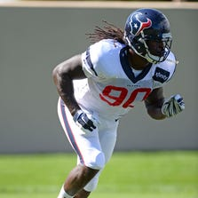 Aug 20, 2014; Englewood, CO, USA; Houston Texans linebacker Jadeveon Clowney (90) during warm ups before the start of a scrimmage against the Denver Broncos at the Broncos training facility. Mandatory Credit: Ron Chenoy-USA TODAY Sports