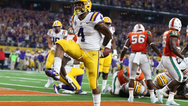 Sep 2, 2018; Arlington, TX, USA; LSU Tigers running back Nick Brossette (4) celebrates scoring a touchdown in the second quarter against the Miami Hurricanes at AT&T Stadium. Mandatory Credit: Matthew Emmons-USA TODAY Sports