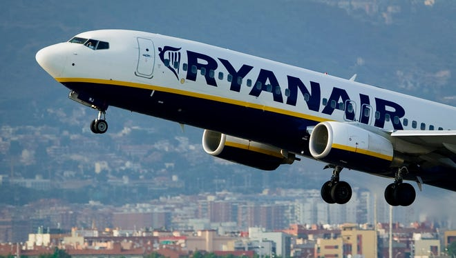This file photo from Sept. 1, 2010, shows a Ryanair Boeing 737 taking off from the Barcelona airport in Spain.