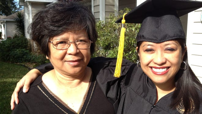Shown is FLORIDA TODAY's entertainment reporter Jennifer Sangalang, right, on her UCF graduation day. Her mom, Aida Sangalang, visited in honor of graduation.