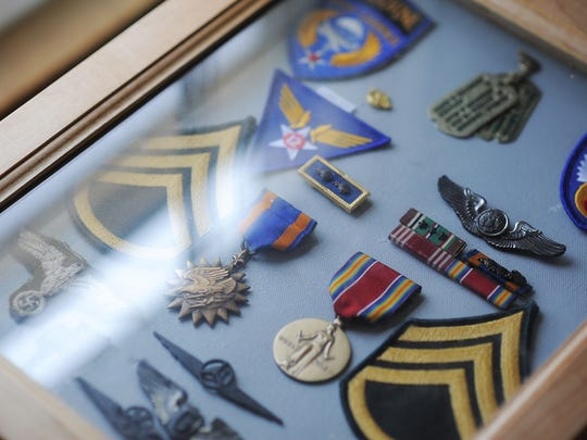 These are items from 92-year-old Ken Salisbury's World War II military career.