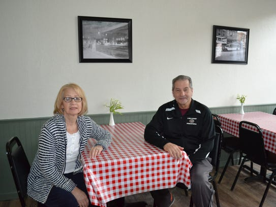Connie and Mike DeStazio sit at their pizza shop, DeSTAZio's