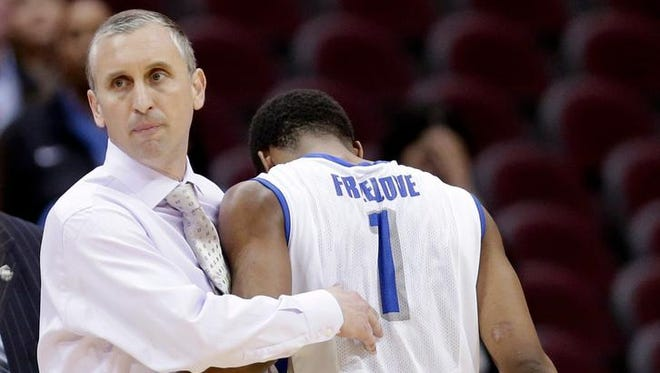 Buffalo coach Bobby Hurley, left, hugs Joshua Freelove as Freelove leaves the court in the final seconds of the second half  against Eastern Michigan at the Mid-American Conference men's tournament Thursday, March 13, 2014, in Cleveland. Eastern Michigan defeated Buffalo 69-64.