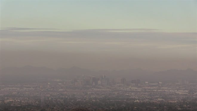 View of haze over downtown Phoenix from South Mountain on Dec. 1, 2017. A high-pollution advisory for the Phoenix metro area has been extended throughWednesday.