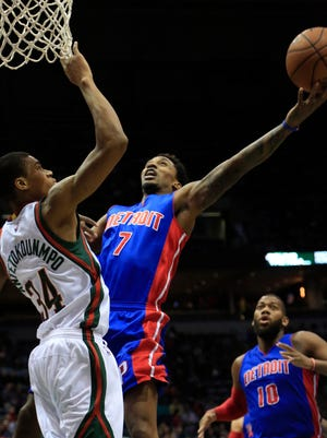 Pistons guard Brandon Jennings (7) goes up for a basket against Bucks forward Giannis Antetokounmpo, left, during the first half in Milwaukee. Jennings left the game in the third quarter with an apparent lower leg injury.