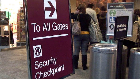 Travelers at Nashville Airport line up for security checks Wednesday, December 24, 2008. A new security checkpoint offers more lanes and three levels of travel expertise to speed the process.