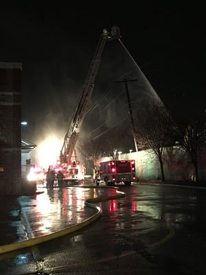 Firefighters battled a fire at an environmental center on Andrews Drive behind an electronics store in Woodland Park Monday night.