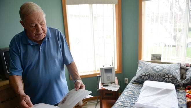 Heart patient Larry Rassier explains how he uses a CardioMEMS monitoring system Thursday, April 21, 2016, in his Waite Park home.