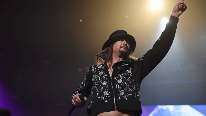 Kid Rock performs at Little Caesars Arena in Detroit on Tuesday night, Sept. 12, 2017. in Detroit on Tuesday, Sept. 12, 2017. His appearance was met by dozens of protesters from a civil rights group. (Tanya Moutzalias/The Ann Arbor News-MLive.com Detroit via AP)