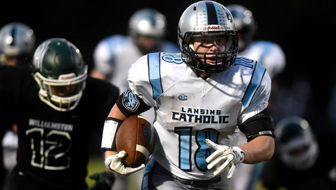 Lansing Catholic's Michael Whitney runs the ball in for a touchdown after a catch during the second quarter on Friday, Sept. 15, 2017, at Larkin-Nortman Memorial Field in Williamston.