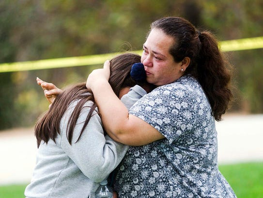 Maria Ortiz consoles her 5th-grade daughter, Crystal