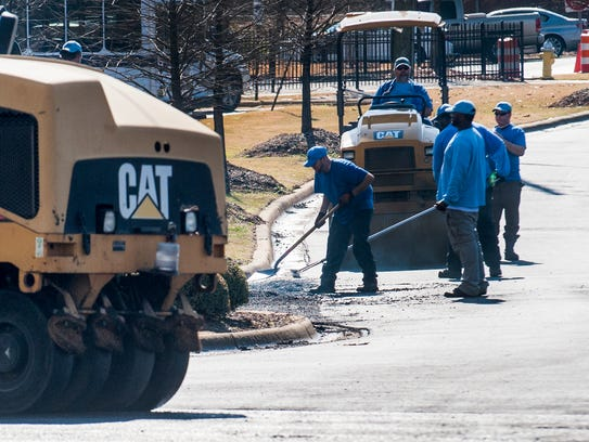 City workers work to resurface Maxwell Blvd. in Montgomery,