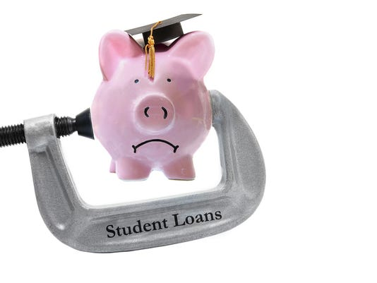 student loan piggy bank in a vice