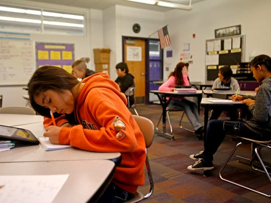 Students use tablets to complete classwork on Friday during state prep math class at Kirtland Middle School in Kirtland.