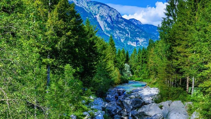 The milky green Soca River flows beneath the Julian