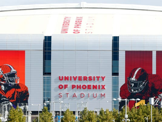 University of Phoenix Stadium is decorated Friday, Jan. 8, 2016, in Glendale, Ariz., for the college football championship game Monday between Clemson and Alabama. (Rob Schumacher/The Arizona Republic via AP)